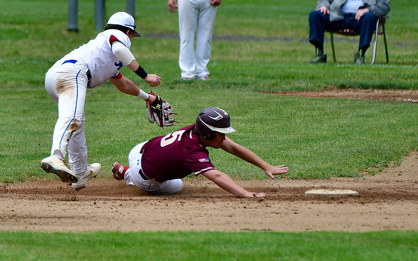 5/29/2019 Mike Orazzi | Staff St. Paul's Ryan Daniels (7) and Sacred Heart's Zachary Laferriere (5) during Wednesday's Class S First Round baseball game in Bristol.