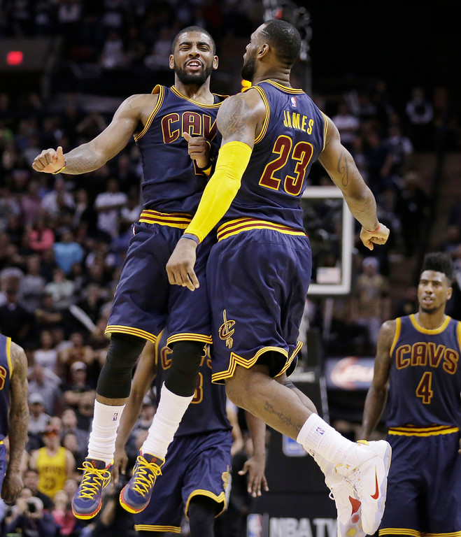. Cleveland Cavaliers� Kyrie Irving (2) and LeBron James (23) celebrate during overtime of an NBA basketball game against the San Antonio Spurs, Thursday, March 12, 2015, in San Antonio. Cleveland won 128-125. Irving scored 57 points. (AP Photo/Eric Gay)