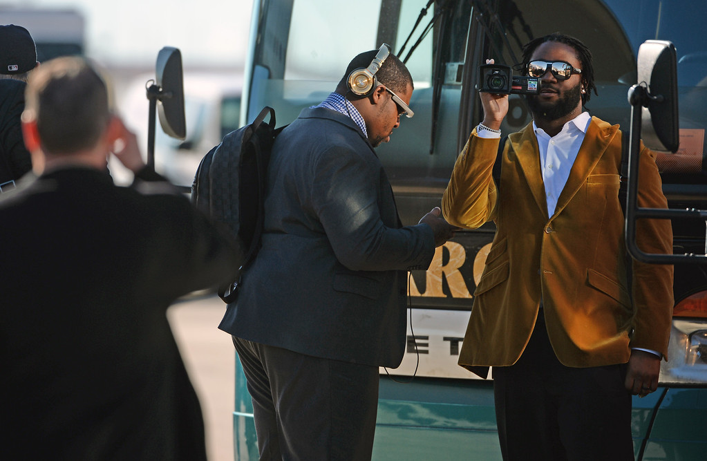 . Denver Broncos\' players take photos as they arrive at the airport to board their United Charter plane in Denver, Co on January 26, 2013.   The entire team, coaches, staff and media boarded the United charter plane to head to New Jersey for the Super Bowl from Denver International Airport. (Photo By Helen H. Richardson/ The Denver Post)