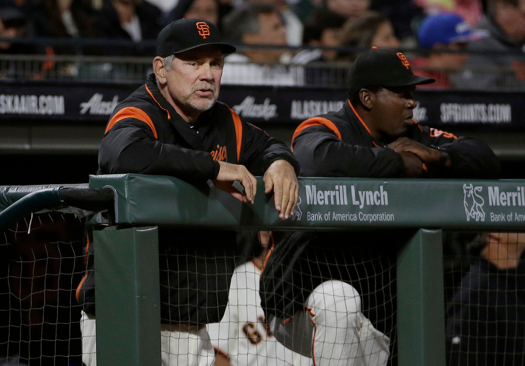 . San Francisco Giants manager Bruce Bochy, left, watches from the dugout with batting coach Hensley Meulens during a baseball game against the Cleveland Indians in San Francisco, Tuesday, July 18, 2017. (AP Photo/Jeff Chiu)