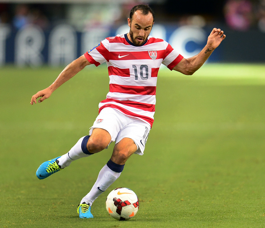 . Landon Donovan of the US controls the ball under pressure against Honduras during their Gold Cup semifinal soccer match in Arlington, Texas, in this July 24, 2013 file photo. Donovan announced on August 7, 2014, that he will retire at the end of the 2014 US Major League Soccer season.  AFP PHOTO/Frederic J. BROWN/AFP/Getty Images