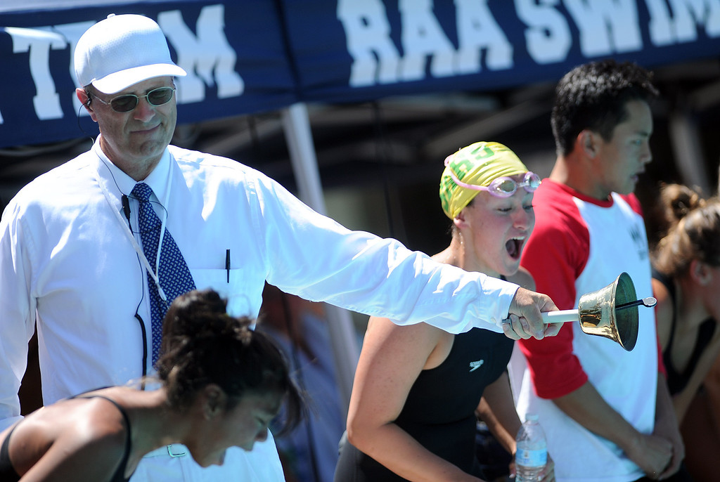 . Official Bill Sullivan rings the bell for the last lap during the 500 freestyle race during the CIF-SS Division II swim finals at Riverside City College on Saturday, May 11, 2013 in Riverside, Calif.  (Keith Birmingham Pasadena Star-News)