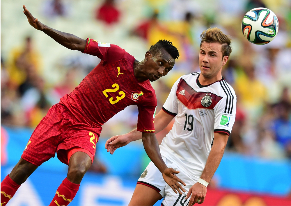 . Ghana\'s defender Harrison Afful (L) vies with Germany\'s forward Mario Goetze during a Group G football match between Germany and Ghana at the Castelao Stadium in Fortaleza during the 2014 FIFA World Cup on June 21, 2014. (JAVIER SORIANO/AFP/Getty Images)