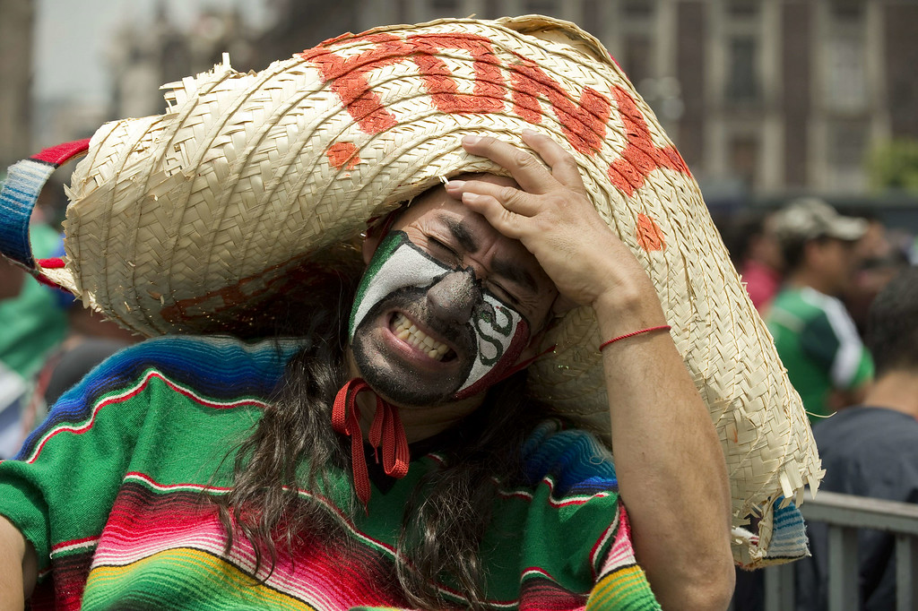 . A Mexican fan shows his dejection at Zocalo Square in Mexico City on June 29, 2014 after the national football team lost to the Netherlands 2-1 in their FIFA World Cup Brazil 2014 second round match. AFP PHOTO/ALFREDO ESTRELLA