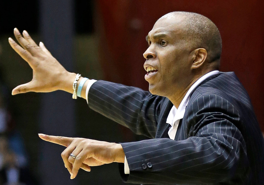 . Texas Southern head coach Mike Davis calls a play against Cal Poly in the second half of a first-round game of the NCAA college basketball tournament on Wednesday, March 19, 2014, in Dayton, Ohio. (AP Photo/Al Behrman)