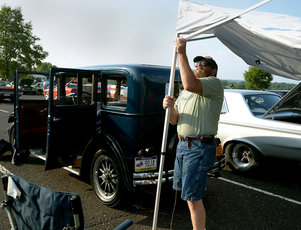 . Rich Shirley sets up a tent behind his 1928 Dodge at the Franconia National Night Out Tuesday, Aug. 5, 2014.Montgomery Media staff photo--Bob Raines