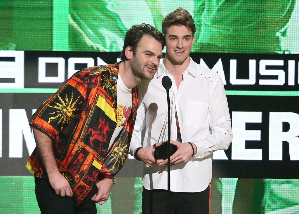 . Alex Pall, left, and Andrew Taggart, of The Chainsmokers, accept the award for favorite artist - electronic dance music at the American Music Awards at the Microsoft Theater on Sunday, Nov. 20, 2016, in Los Angeles. (Photo by Matt Sayles/Invision/AP)