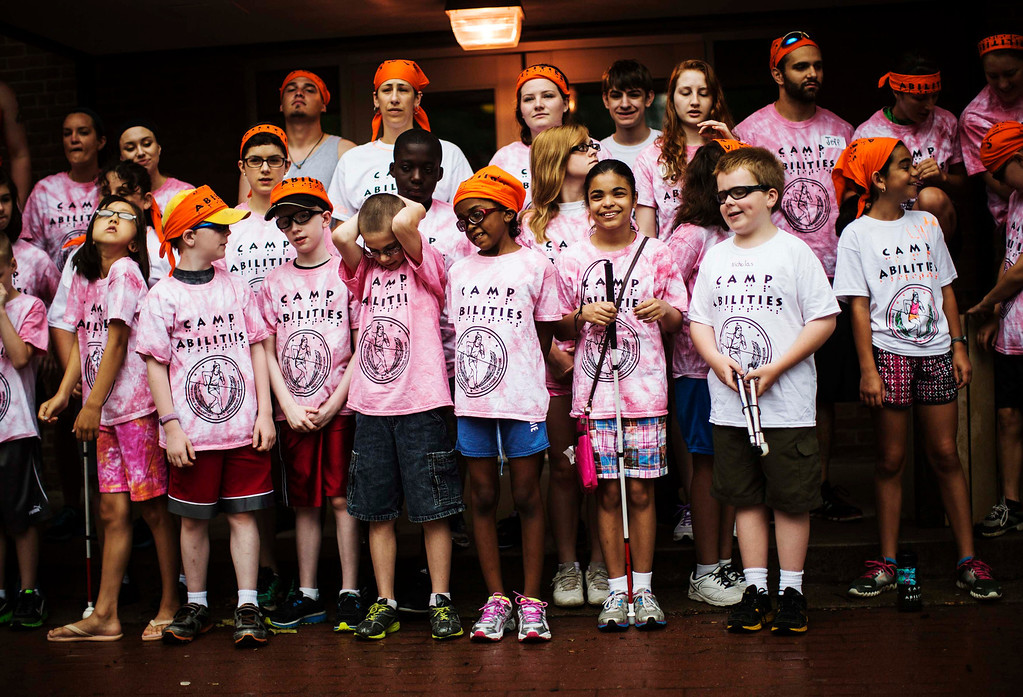 . Children pose for their group photograph at Camp Abilities in Brockport, New York, June 25, 2013.  Camp Abilities is a not-for-profit week-long developmental camp using sports to foster greater independence and confidence in children who are blind, visually impaired, and deaf-blind. Photo taken June 25, 2013. REUTERS/Mark Blinch