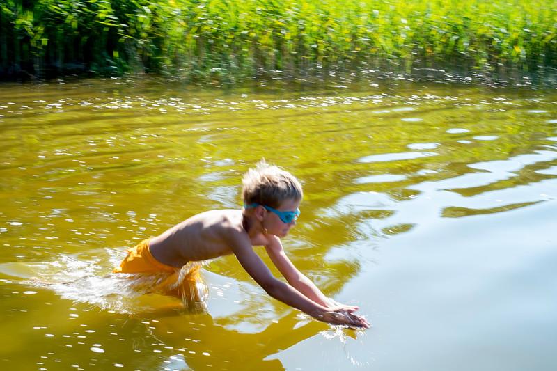 Family enjoying a swim, Gieret Lake, Giby, Poland