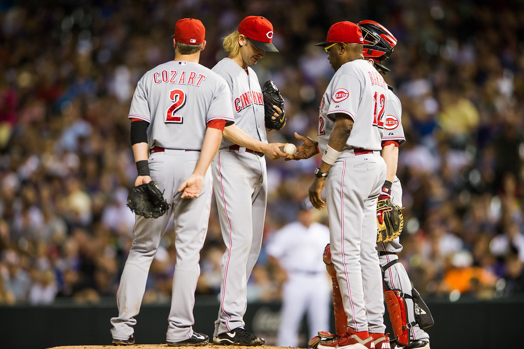 . DENVER, CO - AUGUST 30:  Bronson Arroyo #61 is removed from the game by manager Dusty Baker #12 of the Cincinnati Reds after giving up five earned runs recording one out in the fourth inning of a game at Coors Field on August 30, 2013 in Denver, Colorado. (Photo by Dustin Bradford/Getty Images)