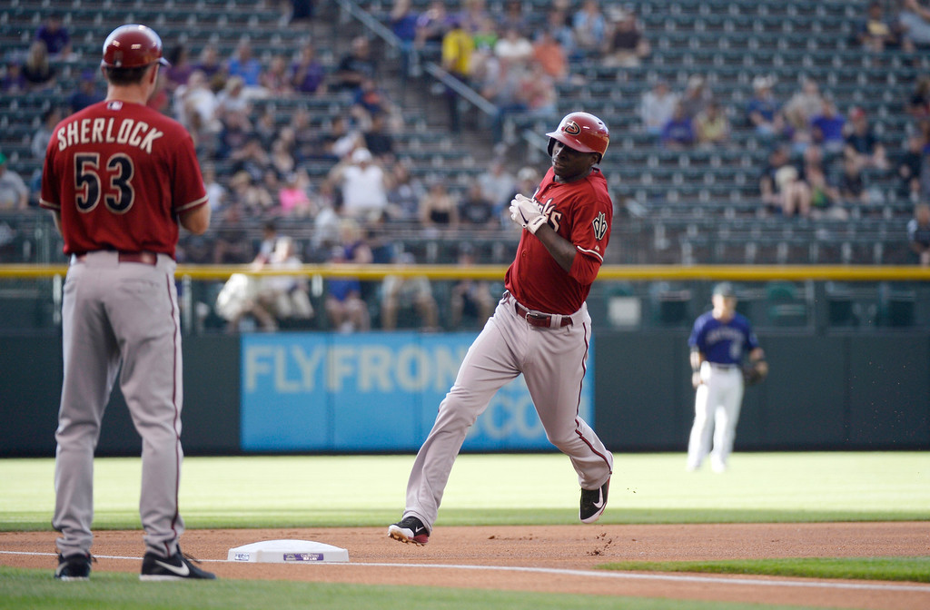 . Arizona Diamondbacks Didi Gregorius (1) round third base after hitting a home run in the first inning against the Colorado Rockies June 4, 2014 at Coors Field. (Photo by John Leyba/The Denver Post)