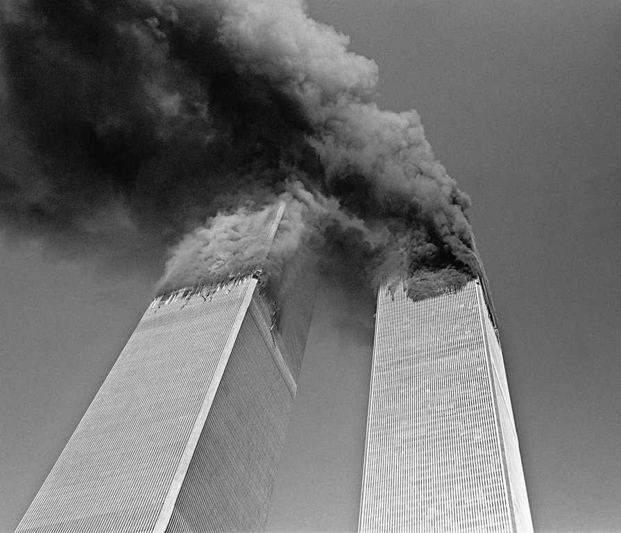 . Smoke billows from the twin towers of the World Trade Center in New York Tuesday Sept. 11, 2001. (AP Photo/Gulnara Samoilova)