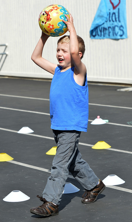 . Chris, 8, of Antioch, prepares to shoot a ball into the basket during a Special Olympics basketball skills event at Turner Elementary School in Antioch, Calif., on Friday March 8, 2013.  (Dan Rosenstrauch/Staff)