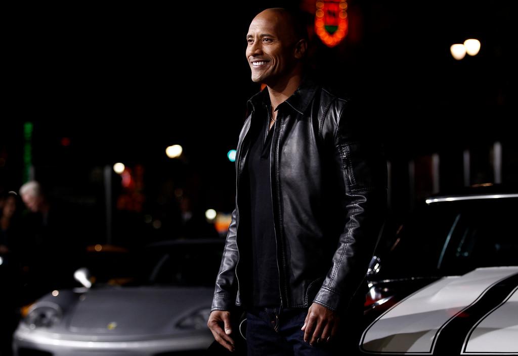 ". Cast member Dwayne Johnson arrives at the premiere of \""Faster\"" in Los Angeles, Monday, Nov. 22, 2010. (AP Photo/Matt Sayles)"