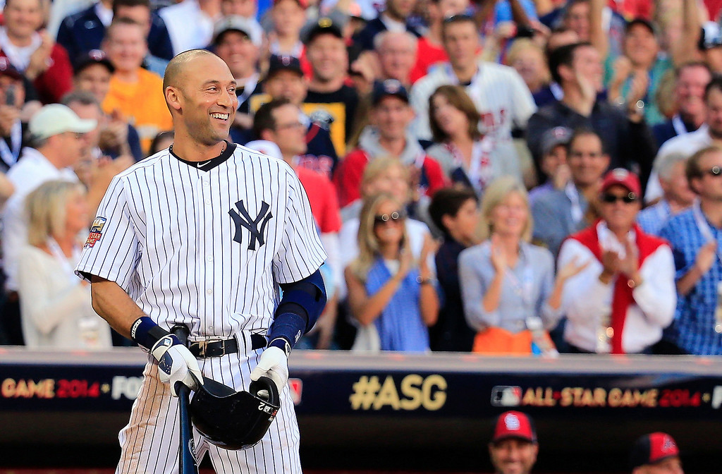 . American League All-Star Derek Jeter #2 of the New York Yankees acknowledges the crowd before his first at bat during the 85th MLB All-Star Game at Target Field on July 15, 2014 in Minneapolis, Minnesota.  (Photo by Rob Carr/Getty Images)