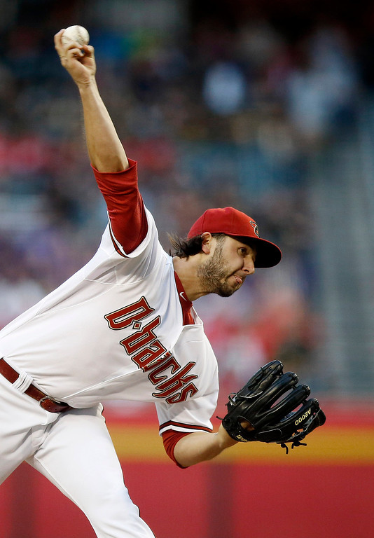 . Arizona Diamondbacks\' Mike Bolsinger throws a pitch against the Colorado Rockies during the first inning of a baseball game on Tuesday, April 29, 2014, in Phoenix. (AP Photo/Ross D. Franklin)