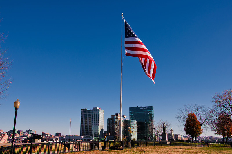 American flag and distant highrises, seen on Federal Hill, Baltimore, Maryland.