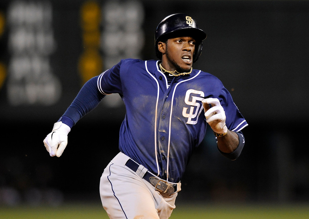 . San Diego Padres Cameron Maybin runs to third base on a triple in the eleventh inning of a baseball game against the Colorado Rockies on Thursday, June 6, 2013 in Denver. The Padres won 6-5 in 12 innings. (AP Photo/Chris Schneider)