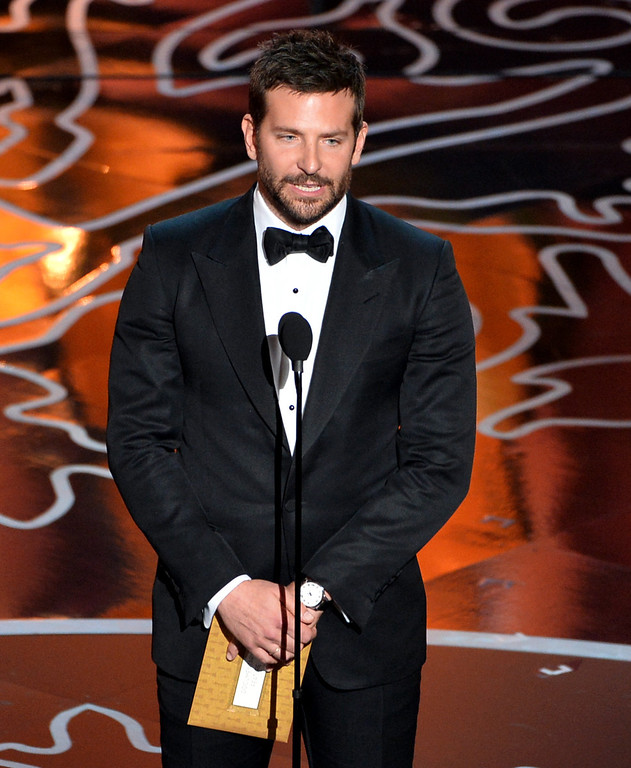 . Actor Bradley Cooper speaks onstage during the Oscars at the Dolby Theatre on March 2, 2014 in Hollywood, California.  (Photo by Kevin Winter/Getty Images)