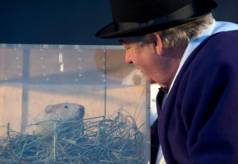. Wiarton, Ontario, Mayor John Close listens to groundhog Wiarton Willie\'s weather prediction in Wiarton on Sunday, Feb. 2, 2014. The groundhog prognosticator predicted 6 more weeks of winter. (AP Photo/The Canadian Press,Frank Gunn)