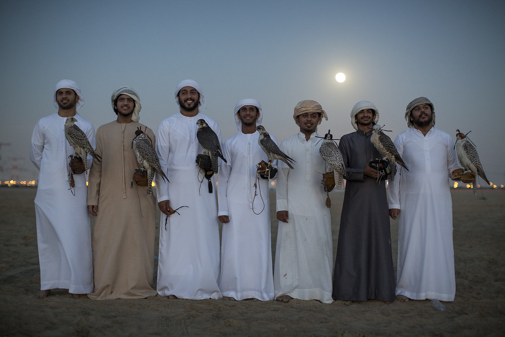 . Emirati men pose with their Falcons after an evening training session on February 3, 2015 in Abu Dhabi, United Arab Emirates. (Photo by Dan Kitwood/Getty Images)