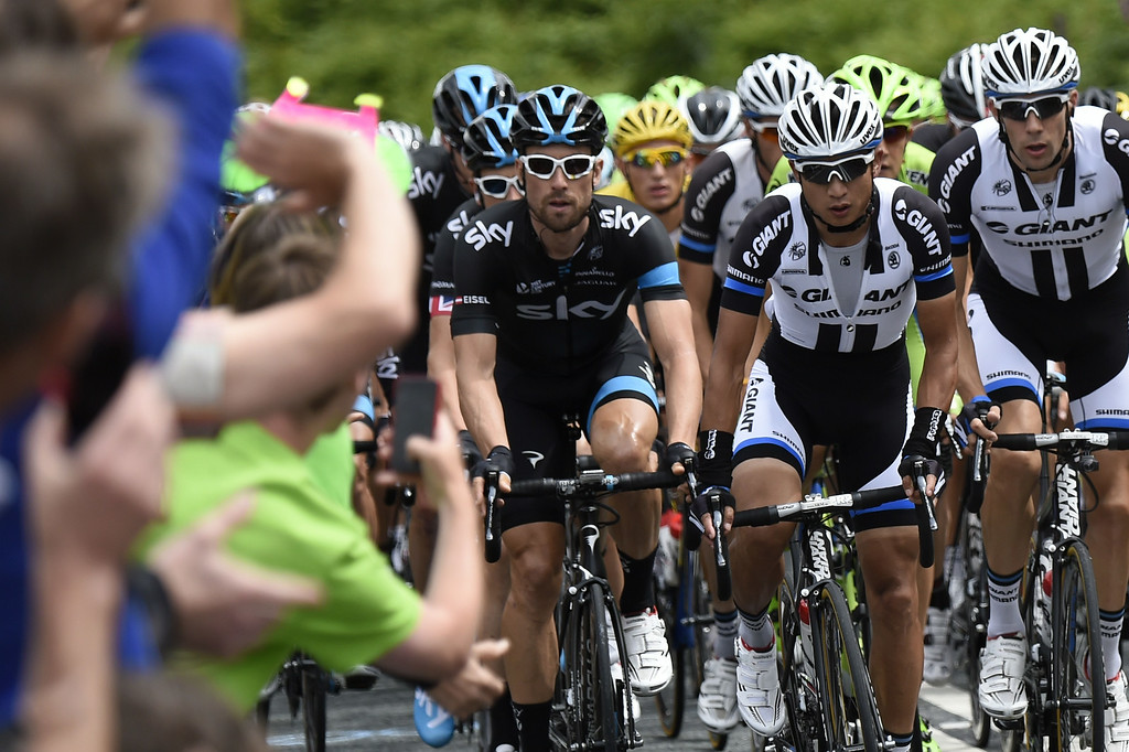 . Austria\'s Bernhard Eisel (L) and China\'s Cheng Ji (C) during the 201 km second stage of the 101th edition of the Tour de France cycling race on July 6, 2014 between York and Sheffield, northern England.  AFP PHOTO / ERIC FEFERBERGERIC FEFERBERG/AFP/Getty Images