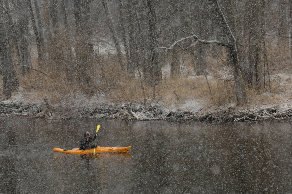 . Bob Gove, Elkhart, kayaks the St. Joseph near along State Road 120 east of Elkhart, Ind., Tuesday March 5, 2013.  Gove says he prefers to kayak on days it snows. Gove was hoping to kayak from one to two hours Tuesday. (AP Photo/Elkhart Truth, J. Tyler Klassen)