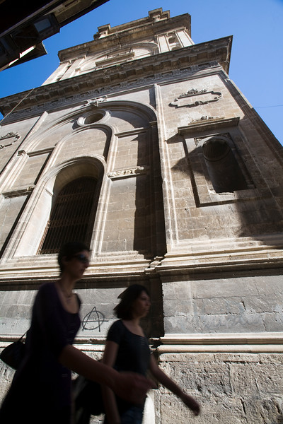 A couple of girls walking in front of Granada's cathedral, Spain