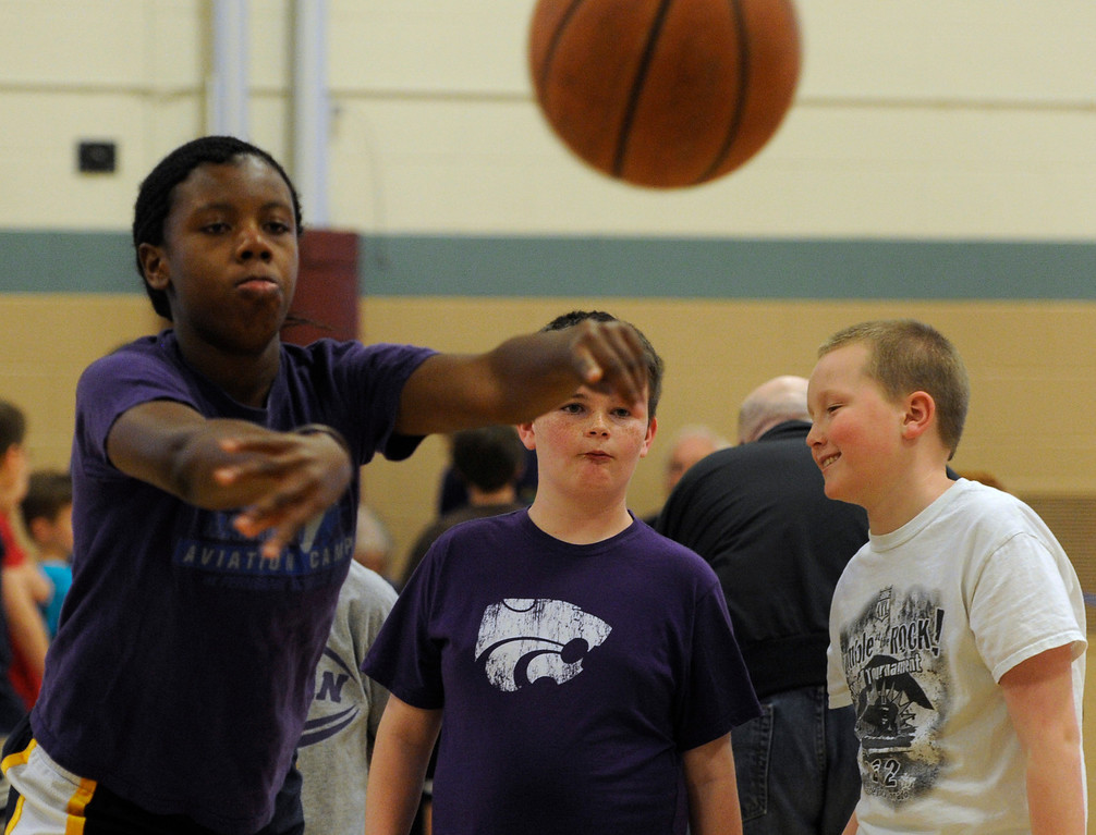 . DENVER, CO. - FEBRUARY 23: Kids watch as Apryl Jackson, 13, takes her turn at the passing skill test. The Tamarac Optimist Club sponsors one of the Tri-Star Basketball Competitions at the Eisenhower Recreation Center in Denver. The competitions are held over a several week period for boys and girls 8-13 years-old. The winners from this competition go on to the regional finals, and those winners will play in the final competition on Mar. 23, 2013 at the Pepsi Center before a Nuggets game. There are still several opportunities for kids to try out. Go to www.tristarbasketball.org for upcoming times and locations. (Photo By Kathryn Scott Osler/The Denver Post)