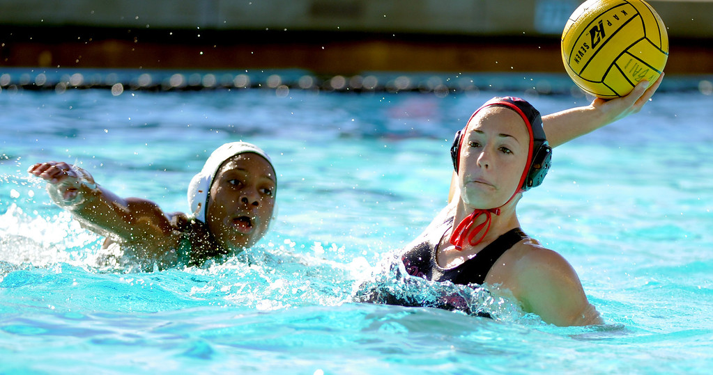 . 02-16-2012--(LANG Staff Photo by Sean Hiller)- Palos Verdes girls water polo defeated Upland 10-8 in Saturday\'s CIF Southern Section Division III quarterfinal at Palos Verdes High School. Ellie D\'Ambra takes a shot and scores under guard by Upland\'s Blair Macdonold (10).