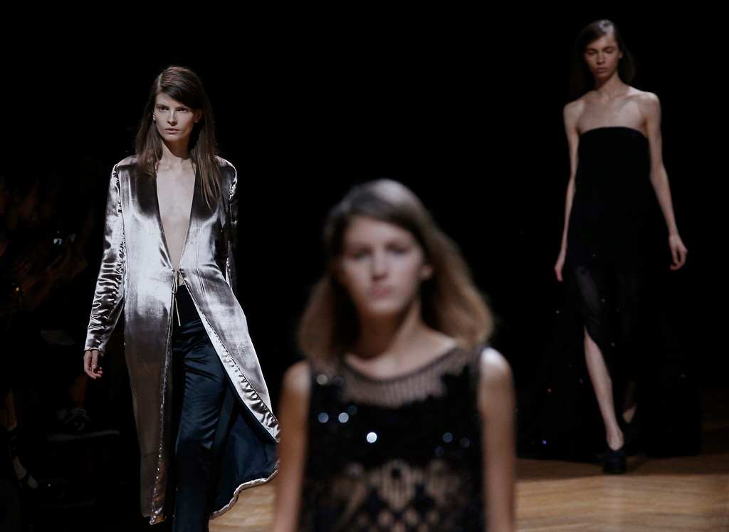 . Models wear creatiosn for Irish fashion designer Sharon Wauchob\'s ready-to-wear Spring/Summer 2014 fashion collection, presented in Paris, Thursday, Sept.26, 2013. (AP Photo/Christophe Ena)