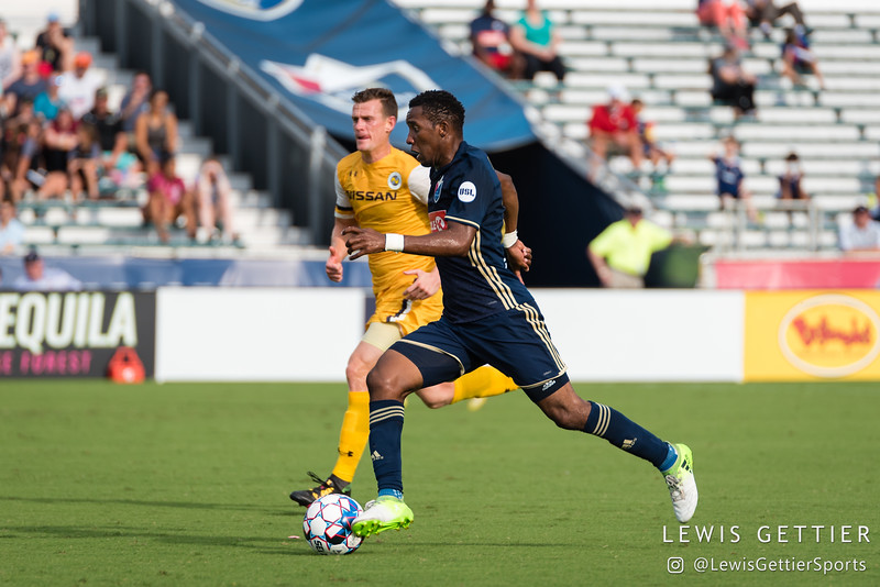 Nashville SC midfielder Michael Reed (17) and North Carolina FC midfielder Tiyi Shipalane (22)
