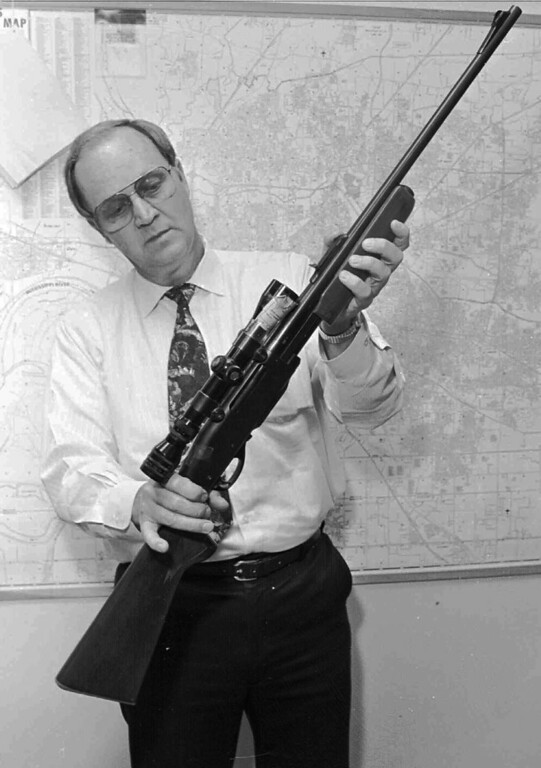 . The Remington 30.06 rifle thought to have killed Rev. Martin Luther King, Jr.,  is shown by then Criminal Court property clerk Ben Holley in this 1992 file photo. Tests were scheduled to begin Wednesday, May 14, 1997 to determine if it is the weapon that killed Martin Luther King Jr. A team of weapons and ballistics experts should have a final report next month. (AP Photo/ John L. Focht)