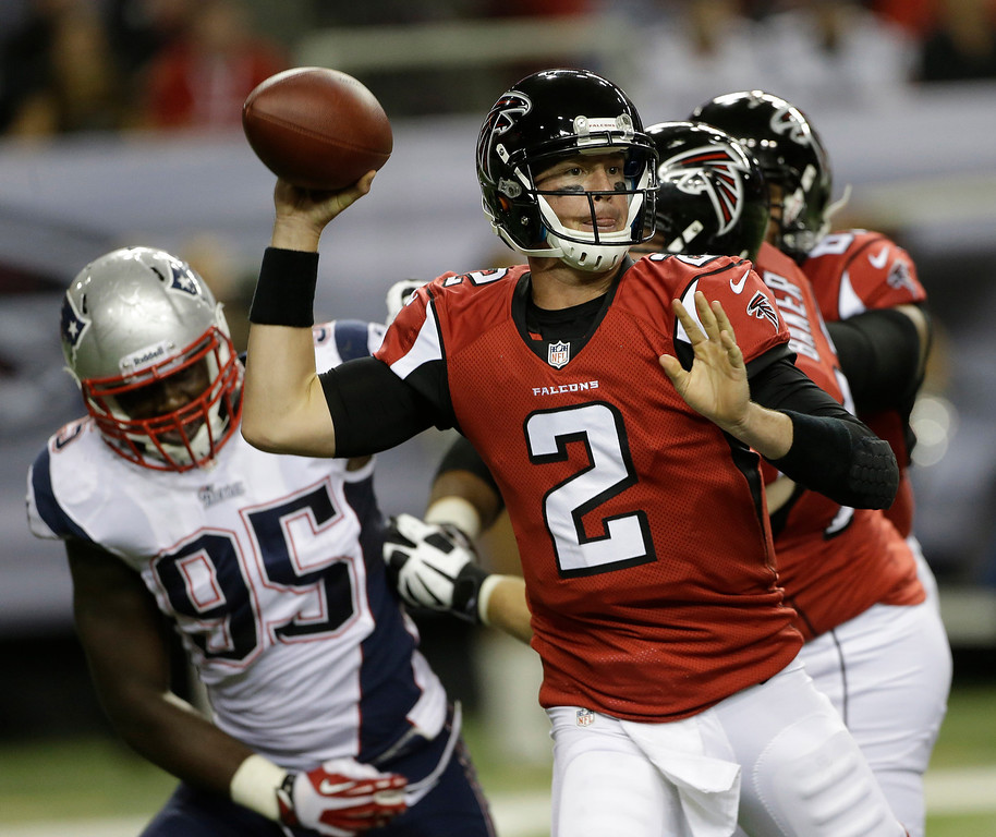 . Atlanta Falcons quarterback Matt Ryan (2) works under pressure from New England Patriots defensive end Chandler Jones (95) during the first half of an NFL football game, Sunday, Sept. 29, 2013, in Atlanta. (AP Photo/John Bazemore)