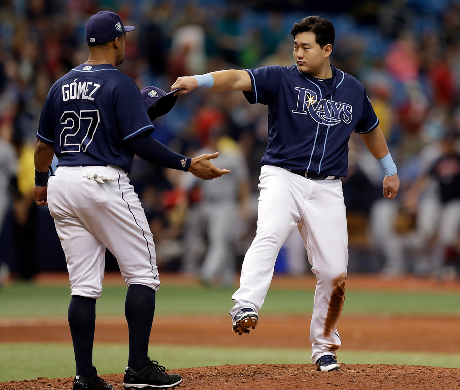 . Tampa Bay Rays\' Ji-Man Choi, of South Korea, celebrates with Carlos Gomez after the Rays defeated the Cleveland Indians 3-1 during a baseball game Wednesday, Sept. 12, 2018, in St. Petersburg, Fla. (AP Photo/Chris O\'Meara)