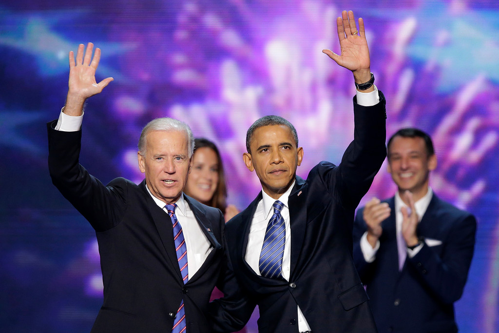 . Vice President Joe Biden and President Barack Obama wave to the delegates at the conclusion of Presdident Obama\'s speech at the Democratic National Convention in Charlotte, N.C., on Thursday, Sept. 6, 2012. (AP Photo/J. Scott Applewhite)
