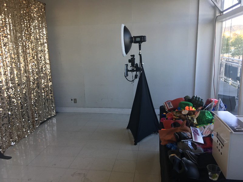 Champagne backdrop with prop table