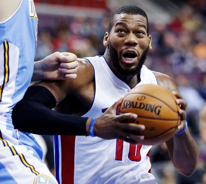 . Detroit Pistons center Greg Monroe (10) drives to the basket against the Denver Nuggets in the first half of an NBA basketball game, Tuesday, Dec. 11, 2012, in Auburn Hills, Mich. (AP Photo/Duane Burleson)