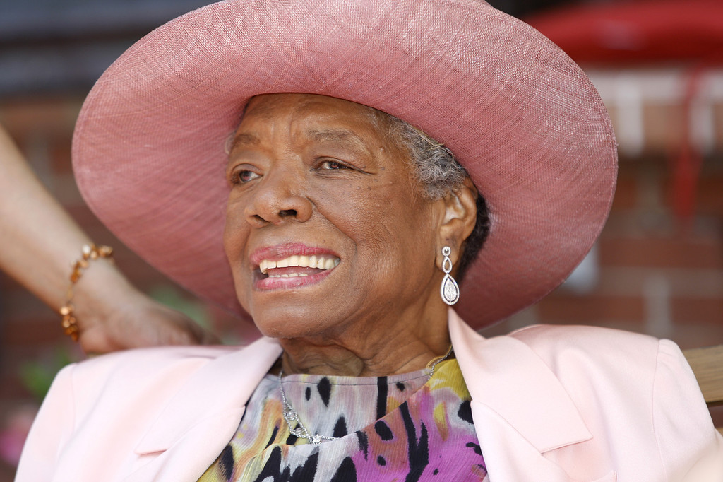 . In this May 20, 2010, file photo, author Maya Angelou socializes during a garden party at her home in Winston-Salem, N.C.  (AP Photo/Nell Redmond, File)
