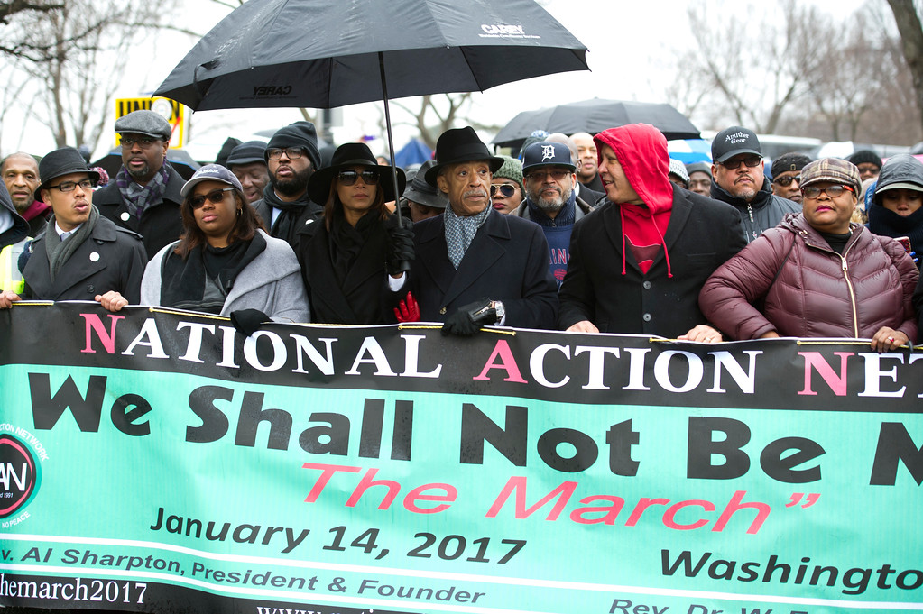 ". Rev. Al Sharpton, center, and civil rights advocates march to honor the Rev. Martin Luther King, Jr. in Washington, Saturday, Jan. 14, 2017. The National Action Network, the group founded by the Rev. Al Sharpton, is sponsoring Saturday\'s ""We Shall Not Be Moved\"" march and rally ahead of Monday\'s Martin Luther King Jr. Day holiday.  (AP Photo/Cliff Owen)"