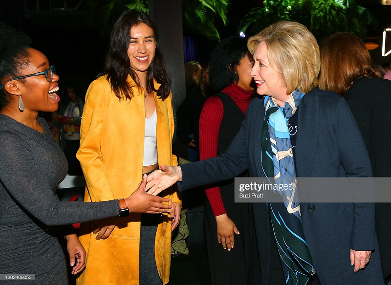 PARK CITY, UTAH - JANUARY 27: Aisha Harris and Shaandiin Tome greet Former U.S. Secretary of State and U.S. Senator, Hillary Rodham Clinton during the 2020 Women at Sundance Celebration hosted by Sundance Institute and Refinery29, Presented by LUNA at Juniper at Newpark on January 27, 2020 in Park City, Utah. (Photo by Suzi Pratt/Getty Images for Refinery29)
