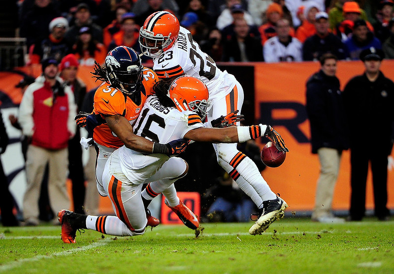 . Cleveland Browns wide receiver Josh Cribbs (16) fumbles a punt in the second half.  The Broncos recovered the ball.  The Denver Broncos vs Cleveland Browns at Sports Authority Field Sunday December 23, 2012. AAron  Ontiveroz, The Denver Post