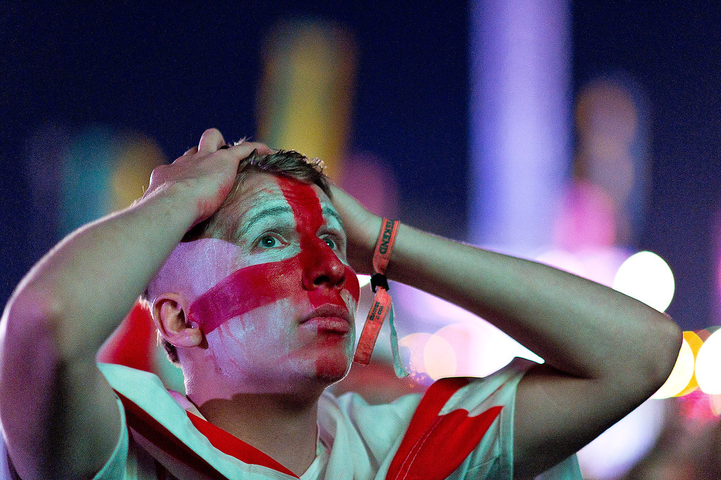 . Fans watch the England vs Italy match at The Isle of Wight Festival at Seaclose Park on June 14, 2014 in Newport, Isle of Wight.  (Photo by Ben A. Pruchnie/Getty Images)