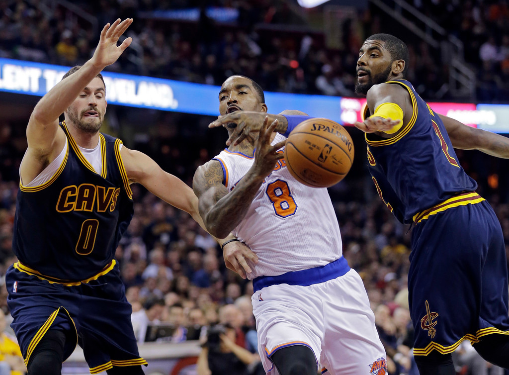 . New York Knicks\' J.R. Smith (8) loses the ball against Cleveland Cavaliers\' Kevin Love (0) and Kyrie Irving in the second quarter of an NBA basketball game Thursday, Oct. 30, 2014, in Cleveland. (AP Photo/Tony Dejak)