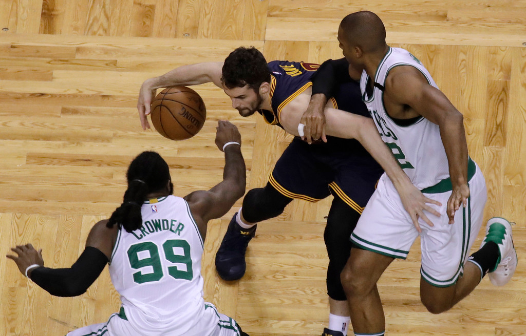 . Boston Celtics forward Jae Crowder (99) and center Al Horford, right, defend against Cleveland Cavaliers forward Kevin Love, center, during first half of Game 2 of the NBA basketball Eastern Conference finals, Friday, May 19, 2017, in Boston. (AP Photo/Elise Amendola)