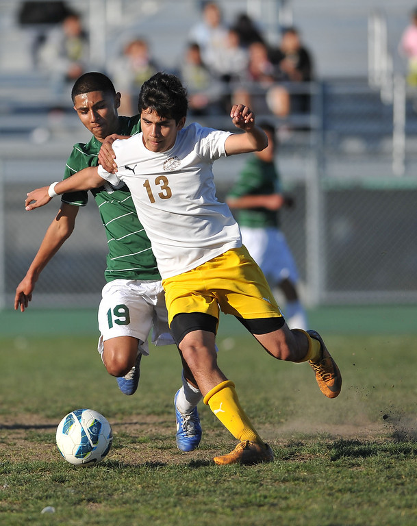 . 2/13/13 - Andrew Perez of Narbonne High School battles for the ball against  Damian Rivera of Kennedy during the L.A. City Section Division I playoffs. Narbonne won 1-0. Photo by Brittany Murray / Staff Photographer