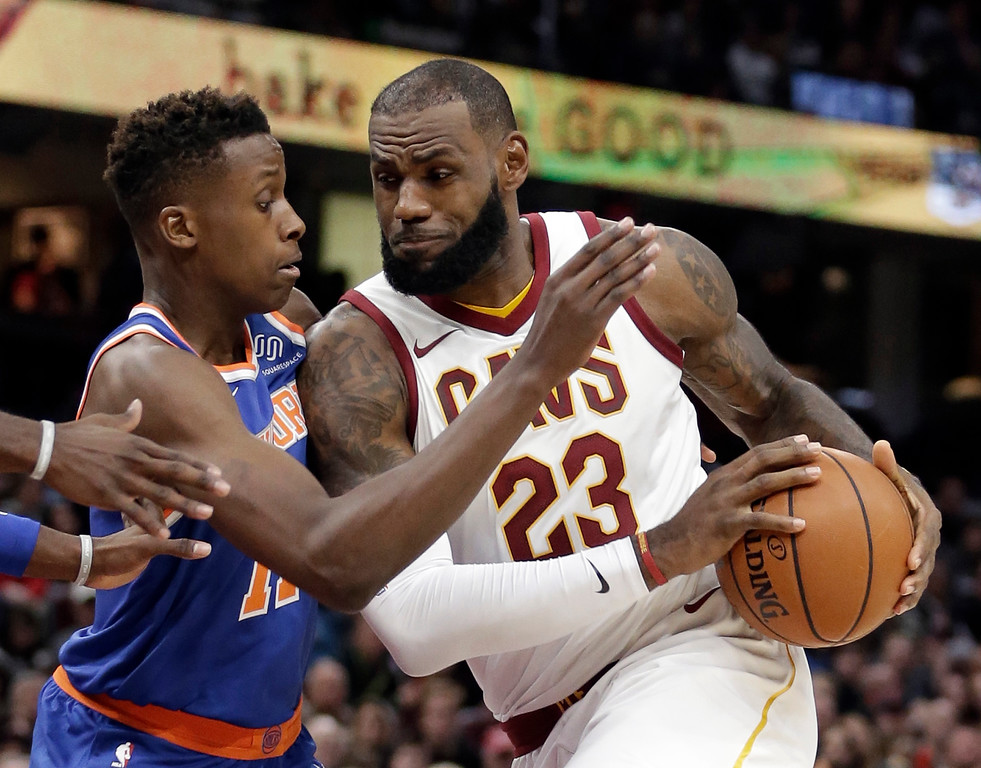 . Cleveland Cavaliers\' LeBron James, right, drives past New York Knicks\' Frank Ntilikina, from France, in the first half of an NBA basketball game, Sunday, Oct. 29, 2017, in Cleveland. (AP Photo/Tony Dejak)