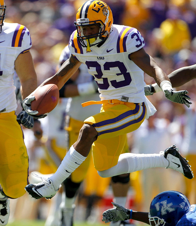 . LSU wide receiver Odell Beckham Jr. leaps over Kentucky\'s Randall Burden en route to a touchdown during the second quarter. Louisiana State University defeated the University of Kentucky on October 1, 2011, in Baton Rouge, Louisiana. Beckham was the 12th pick overall in the first round of the 2014 NFL Draft. (David Perry/Lexington Herald-Leader/MCT)