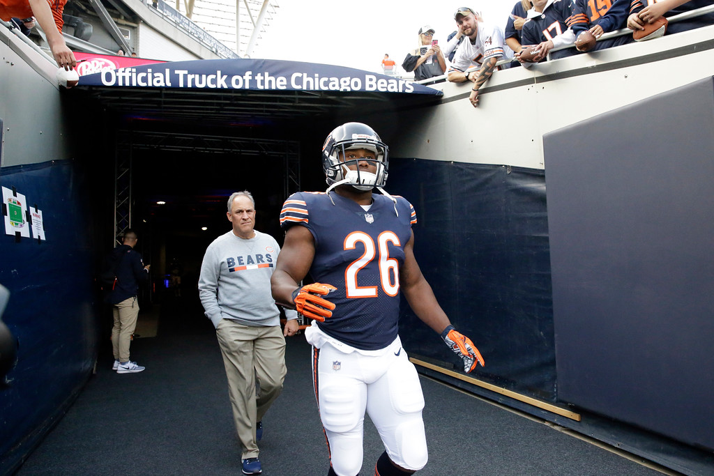 . Chicago Bears running back Benny Cunningham (26) runs to the field before an NFL football game against the Cleveland Browns, Thursday, Aug. 31, 2017, in Chicago. (AP Photo/Nam Y. Huh)