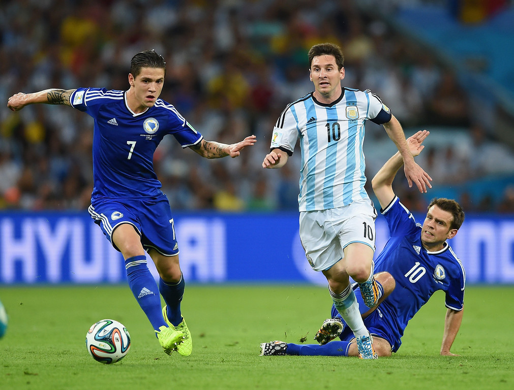. Lionel Messi of Argentina dribbles past Muhamed Besic of Bosnia and Herzegovina to score his team\'s second goal during the 2014 FIFA World Cup Brazil Group F match between Argentina and Bosnia-Herzegovina at Maracana on June 15, 2014 in Rio de Janeiro, Brazil.  (Photo by Matthias Hangst/Getty Images)